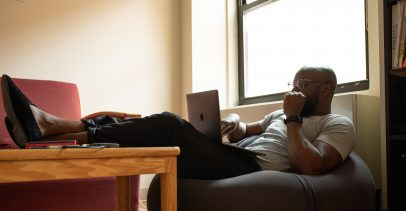 Man sitting on a beanbag using a laptop